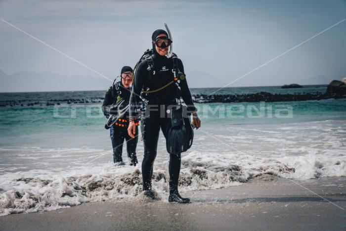 scubadiversin full scuba gear exit on a beach