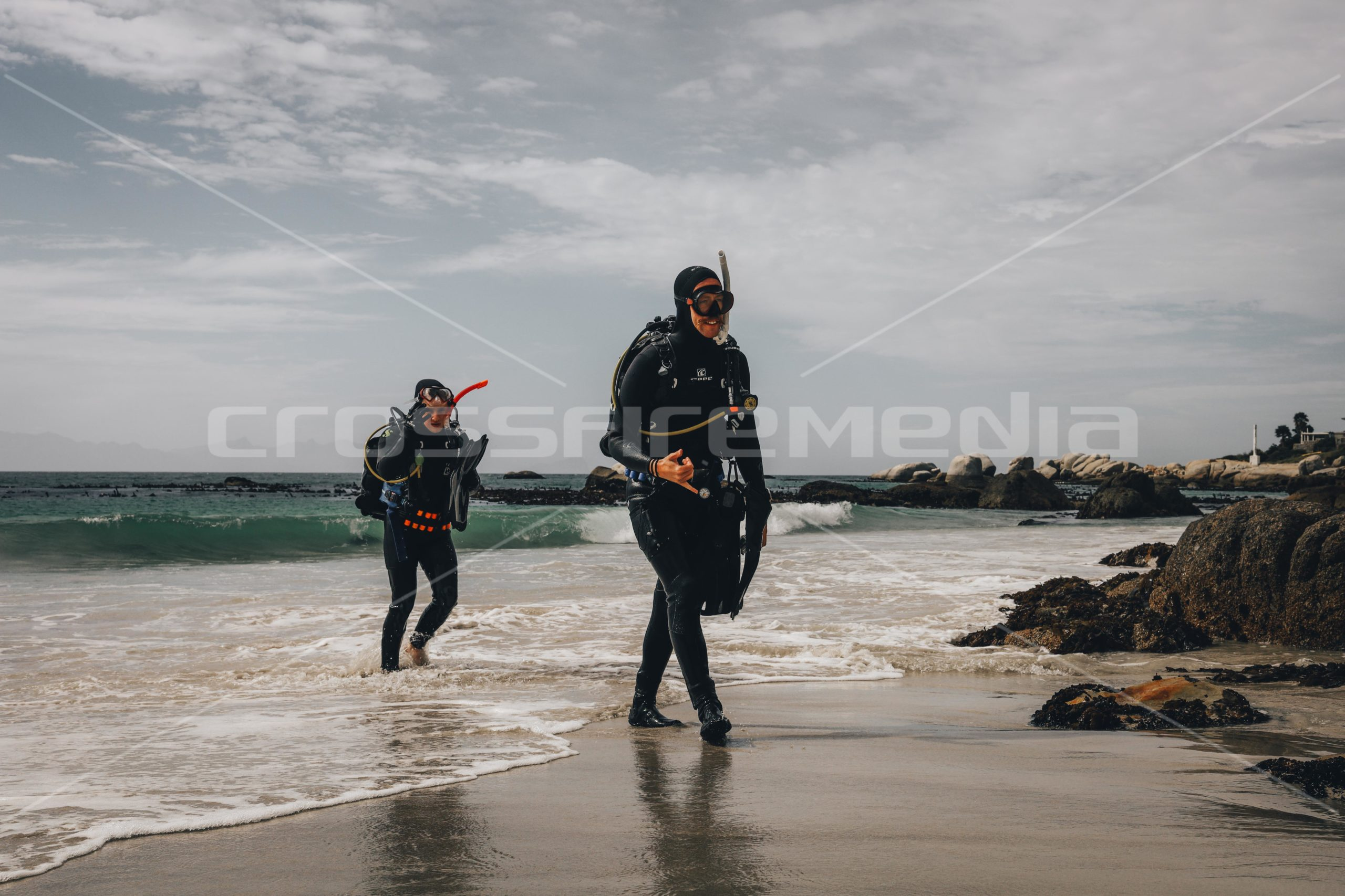 scubadivers on the beach after diving