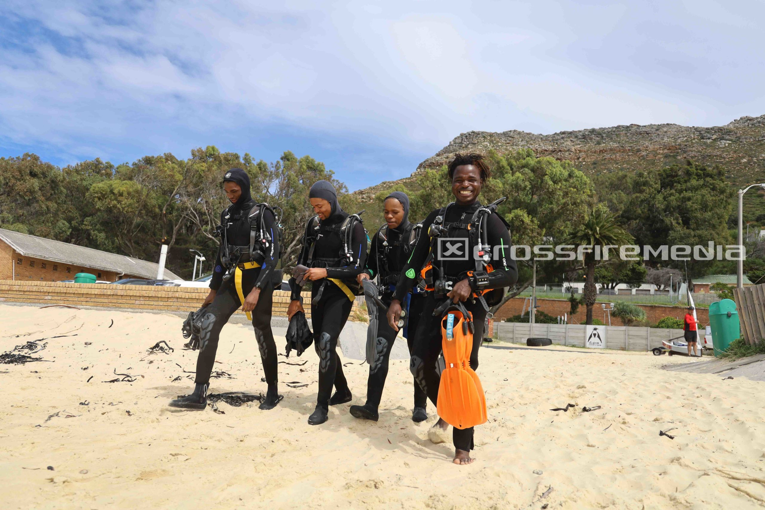 product image of scuba divers of color in scuba gear