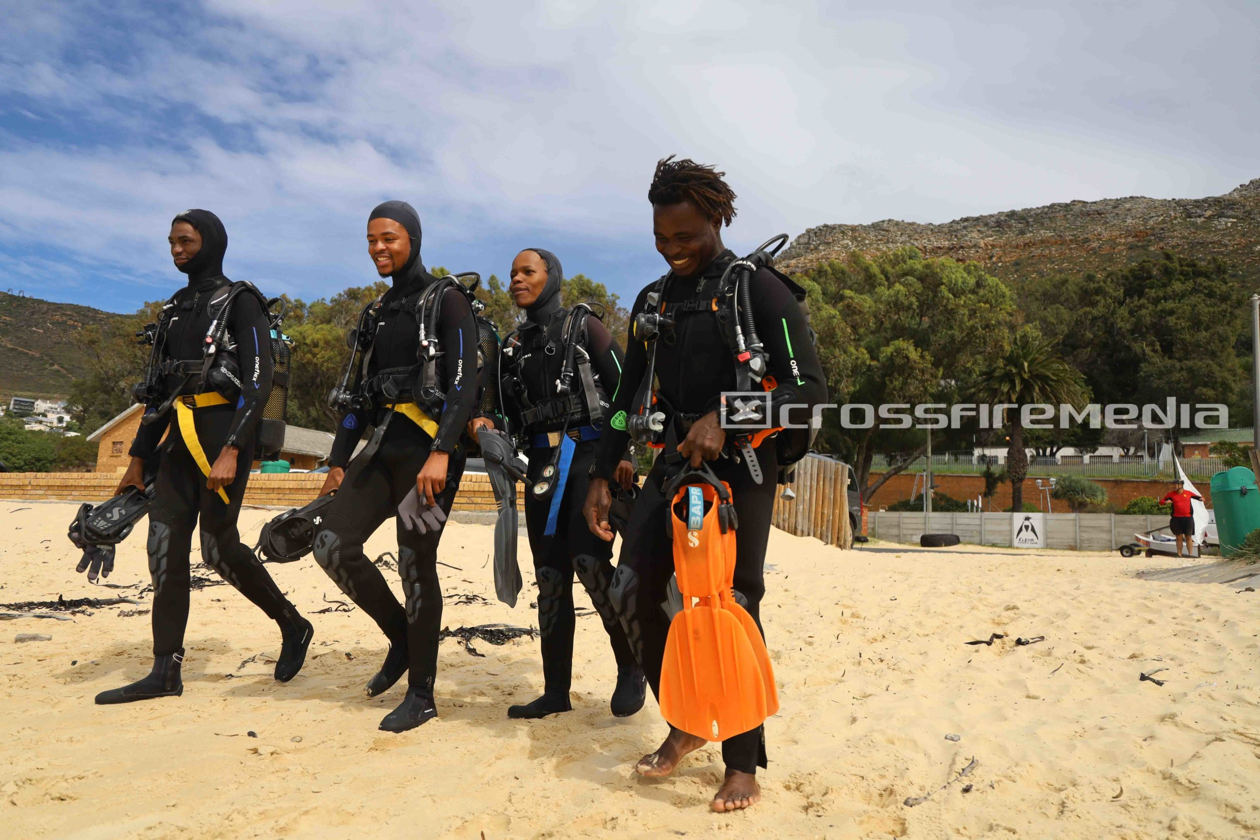product image of scuba divers on beach in scuba gear