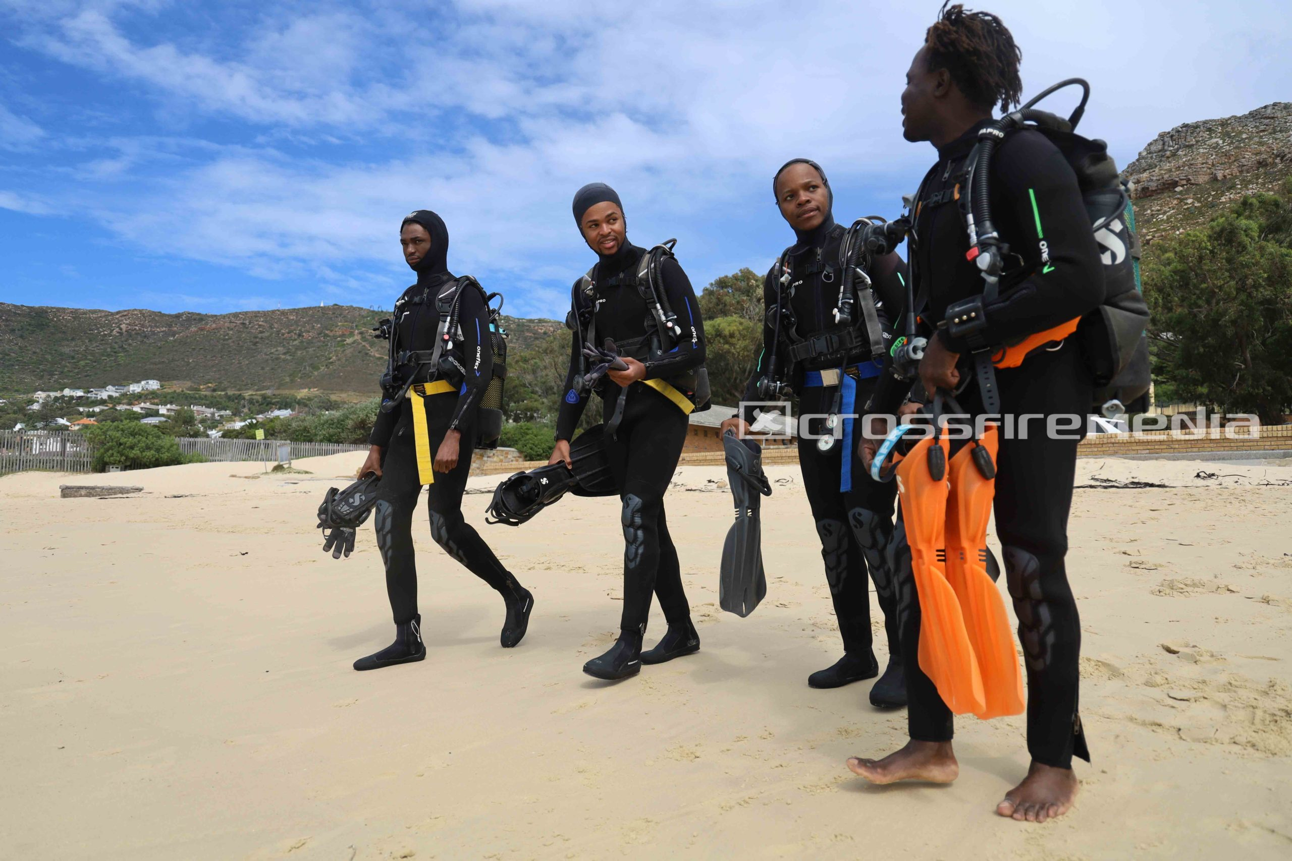 product image of scuba divers in scuba gear on beach