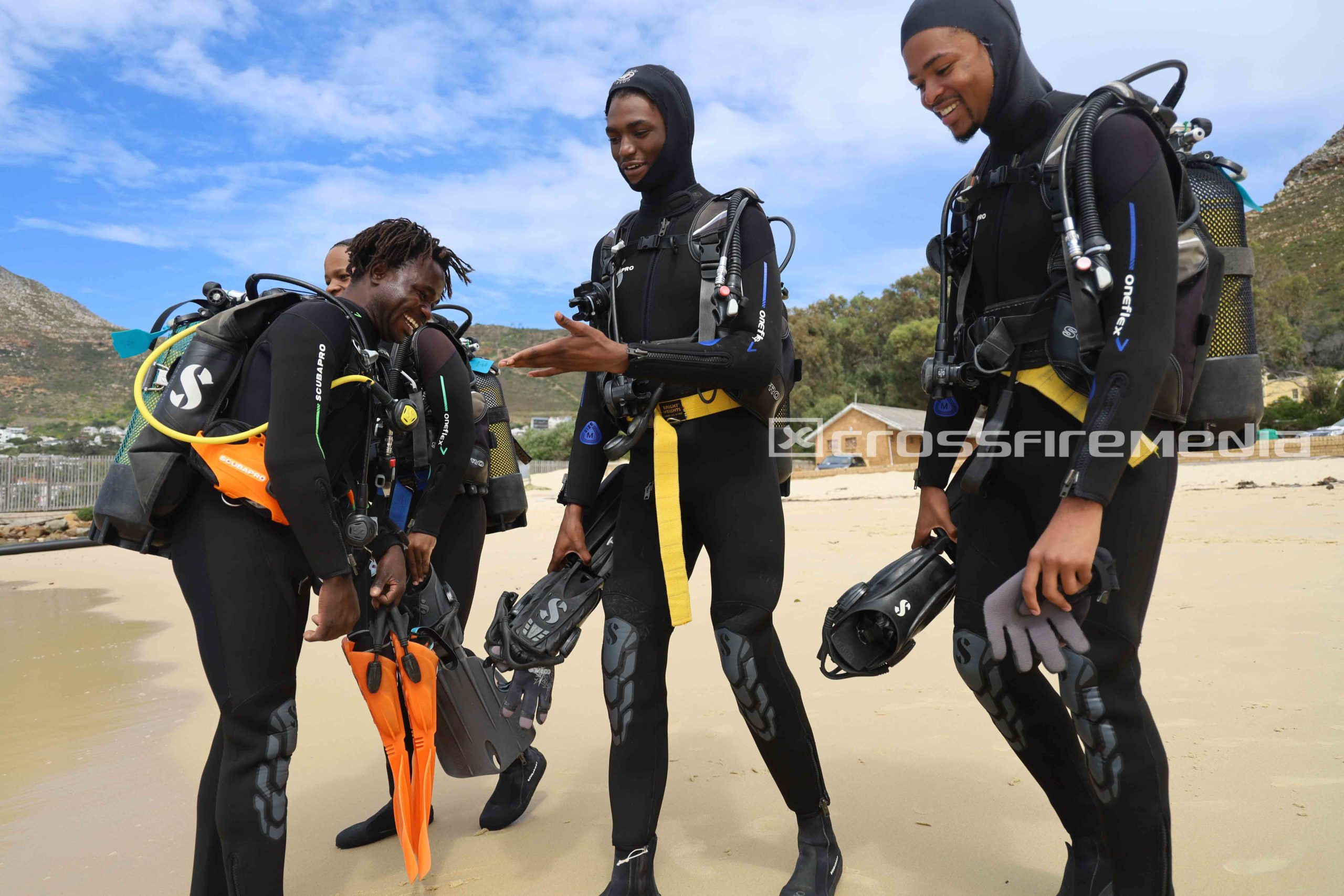 product image of scuba divers on a beach
