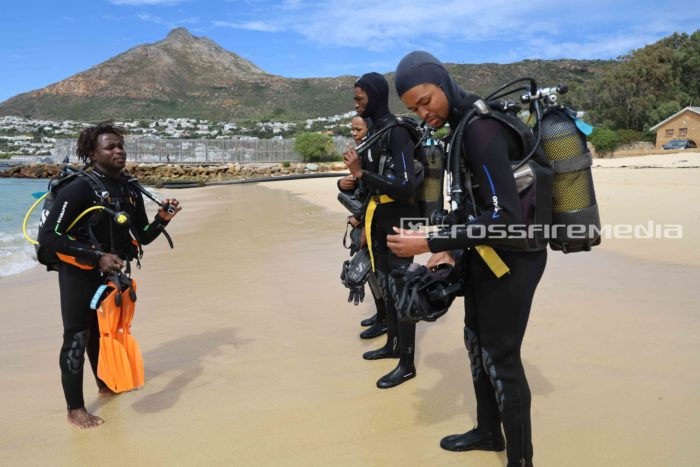 product feature images scuba divers on beach in gear